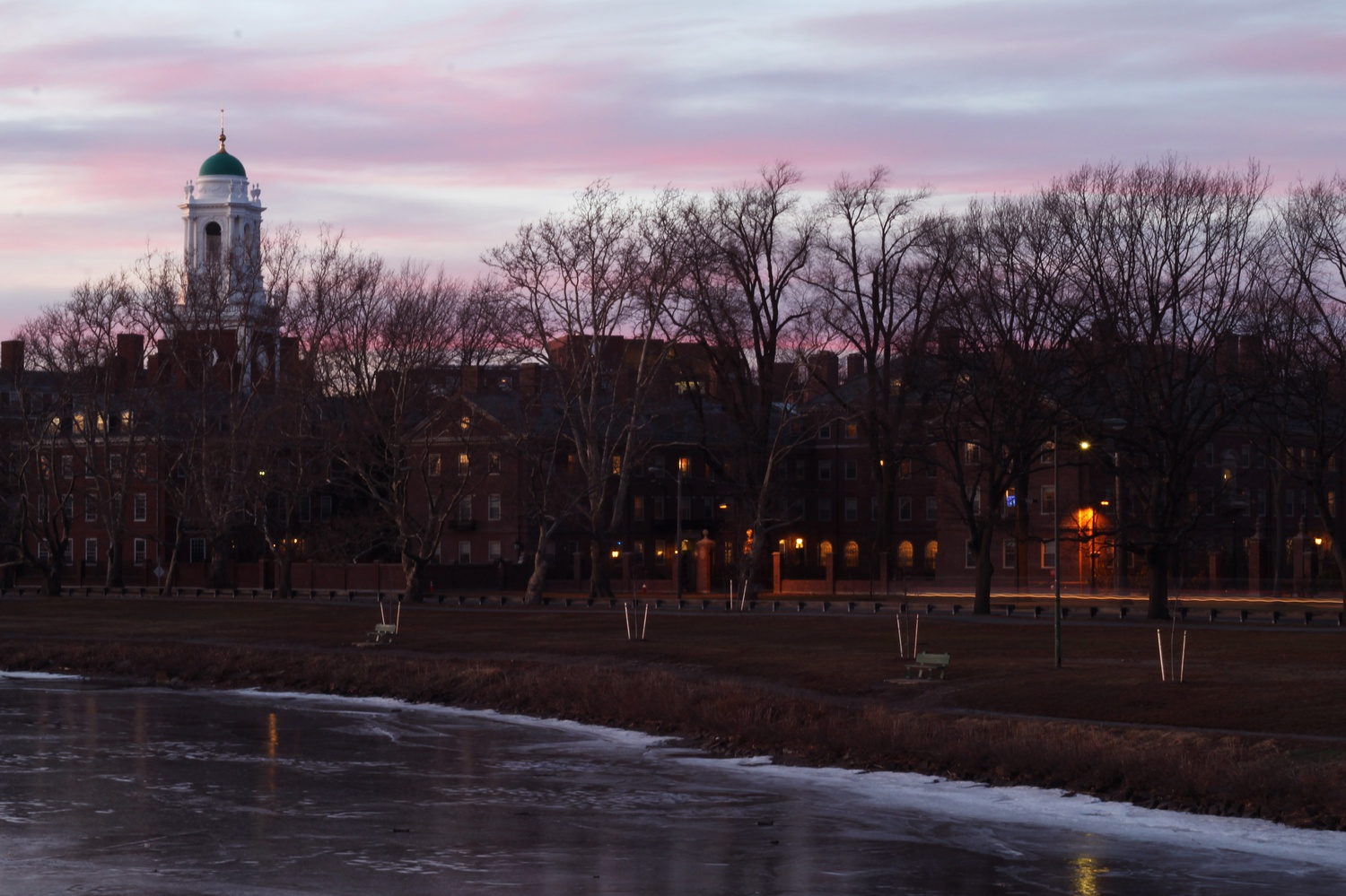 The sun sets on some of Harvard's 12 undergraduate residential Houses Wednesday evening.