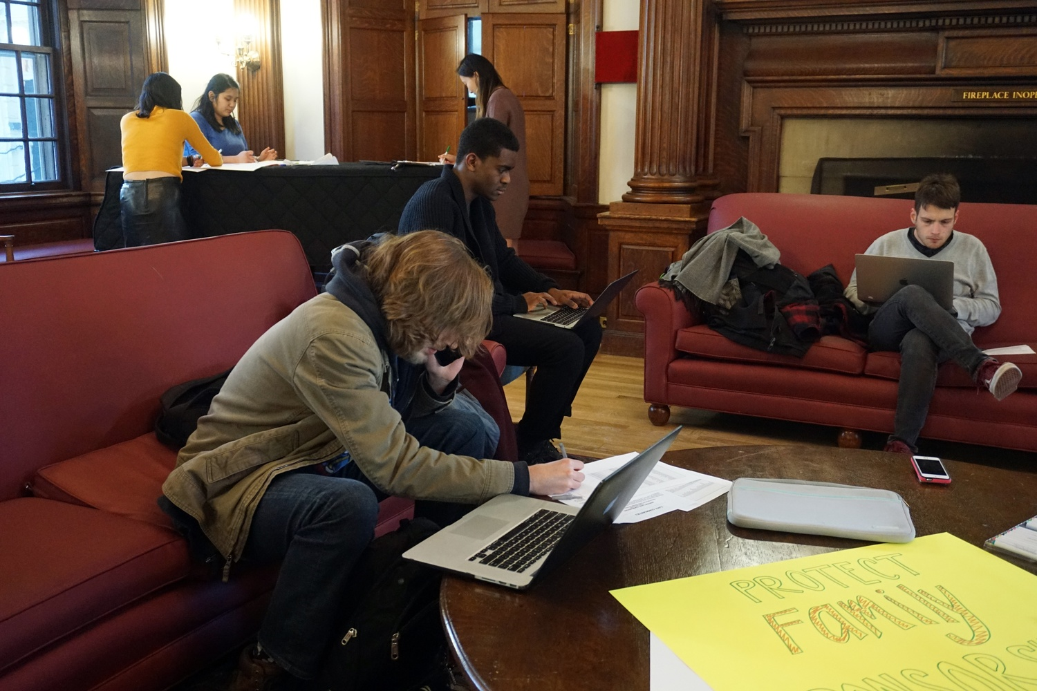 Graduate students gathered in Phillips Brooks House Wednesday afternoon to rally for the Safe Communities Act.