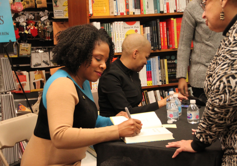 Author Tayari Jones signs copies of her book at The Harvard Book Store Monday night.