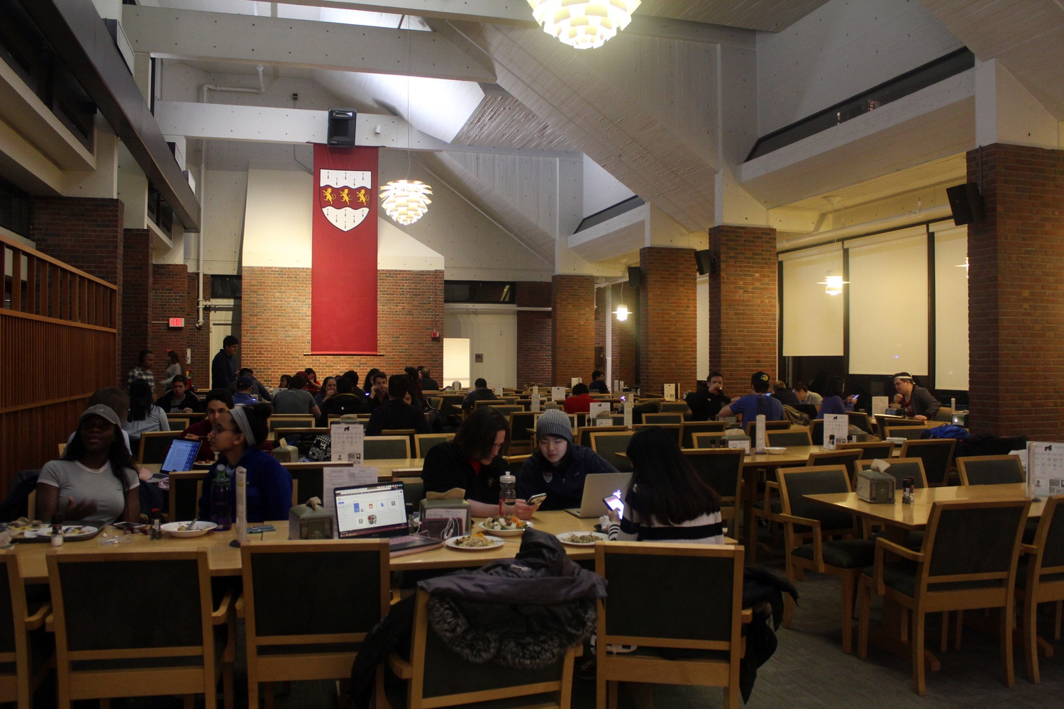Students eat dinner in Mather House dining hall Tuesday evening.
