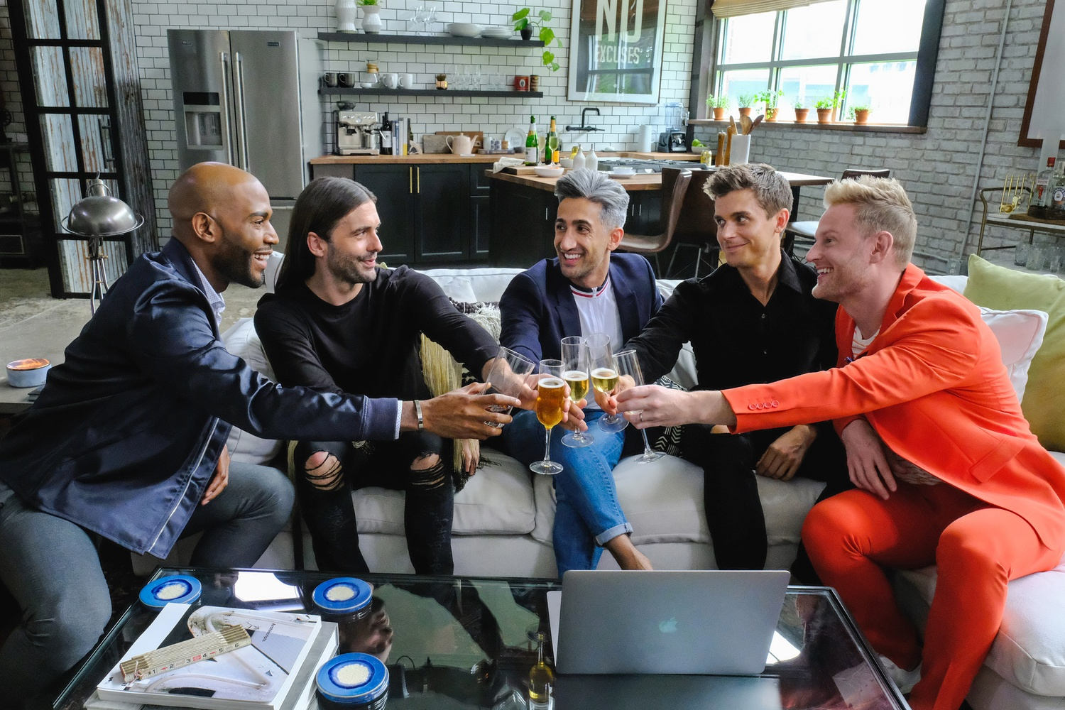 "The Fab Five, a group of five gay men specializing in design (Bobby Berk), culture (Karamo Brown), fashion (Tan France), food and wine (Antoni Porowski), and grooming (Jonathan van Ness), on the Netflix reboot of ""Queer Eye."""
