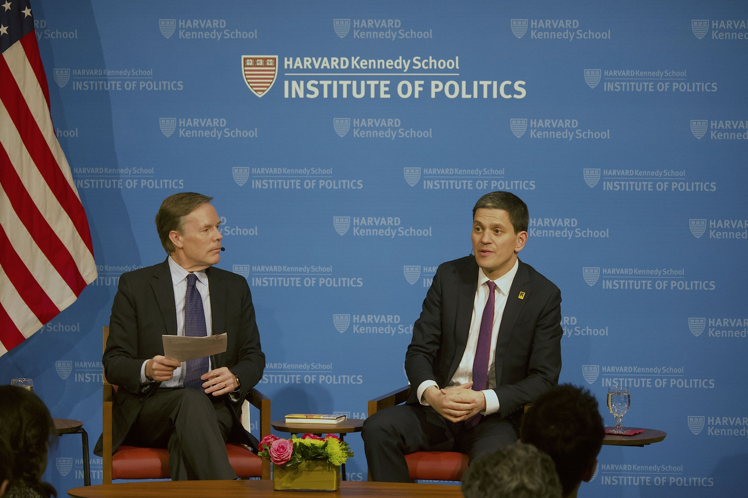 David Miliband (right) spoke Thursday evening at the Institute of Politics in HKS with moderator Nicholas Burns (left) and the audience.
