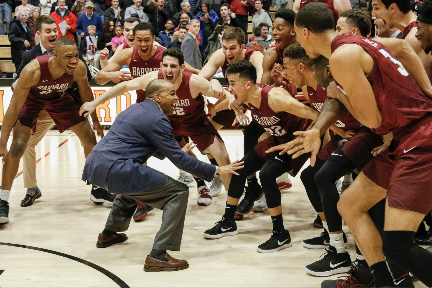 Harvard Men's Basketball coach Tommy Amaker celebrates Harvard's regular season Ivy League title with his team following a 93-74 vicory against Columbia. The team will take on 4-seed Cornell in the first round of the Ivy Madness tournament next Saturday.