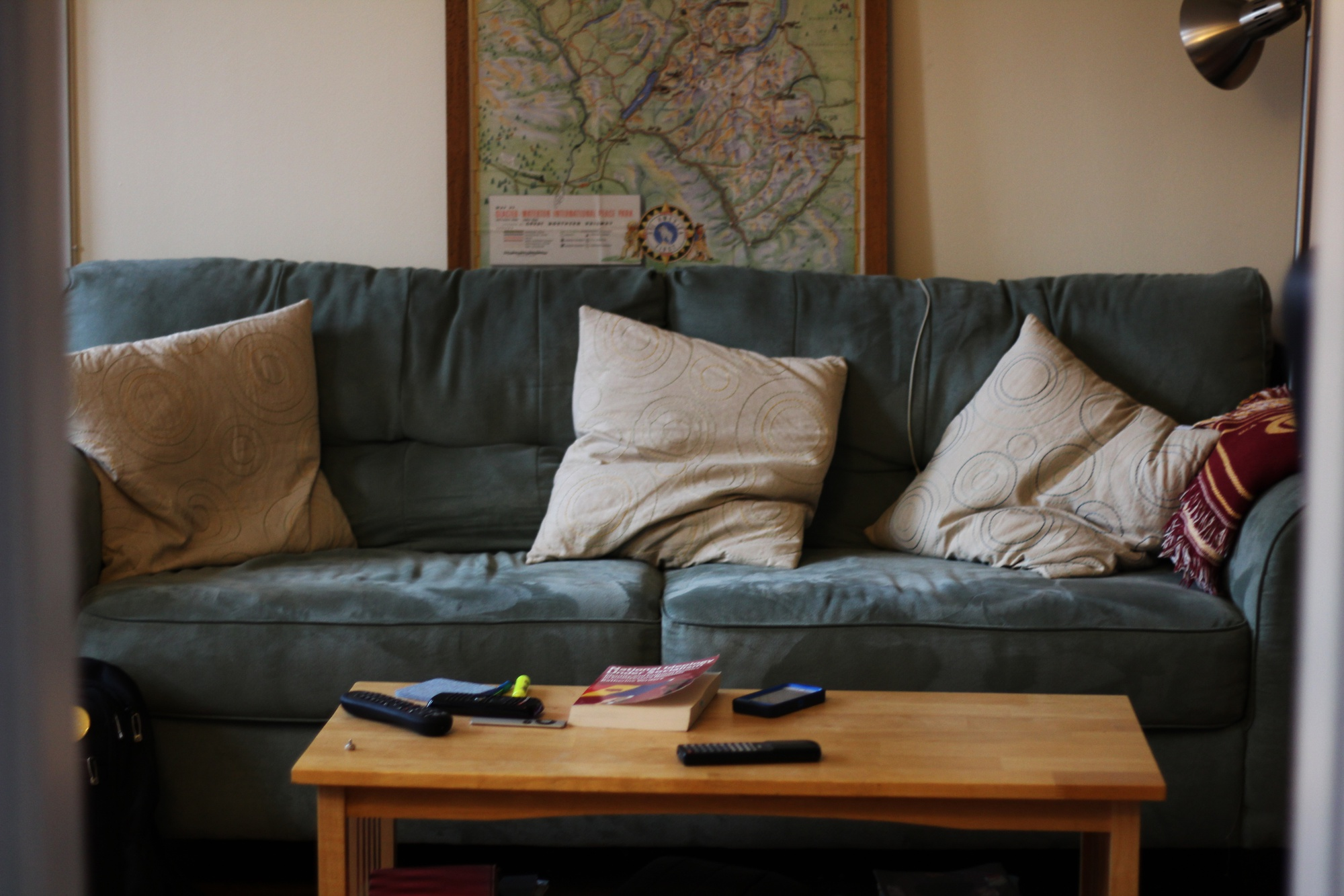 A view of Erin M. Hutchinson's couch and living room decor from the corridor leading to her bedroom.