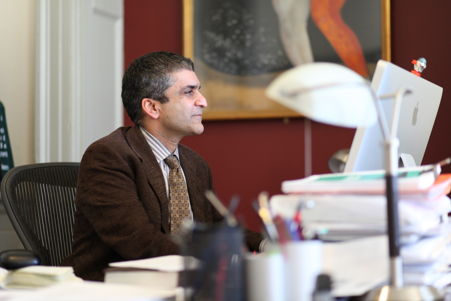 Dean of the College Rakesh Khurana sits at his desk in University Hall.