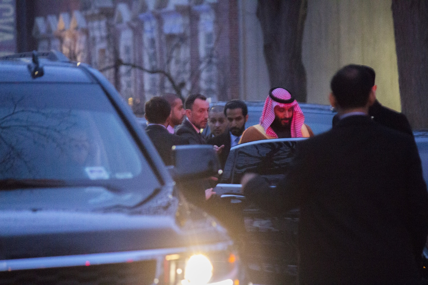 The Crown Prince of Saudi Arabia leaves the Harvard Faculty Club in early 2018 and climbs into a waiting motorcade.