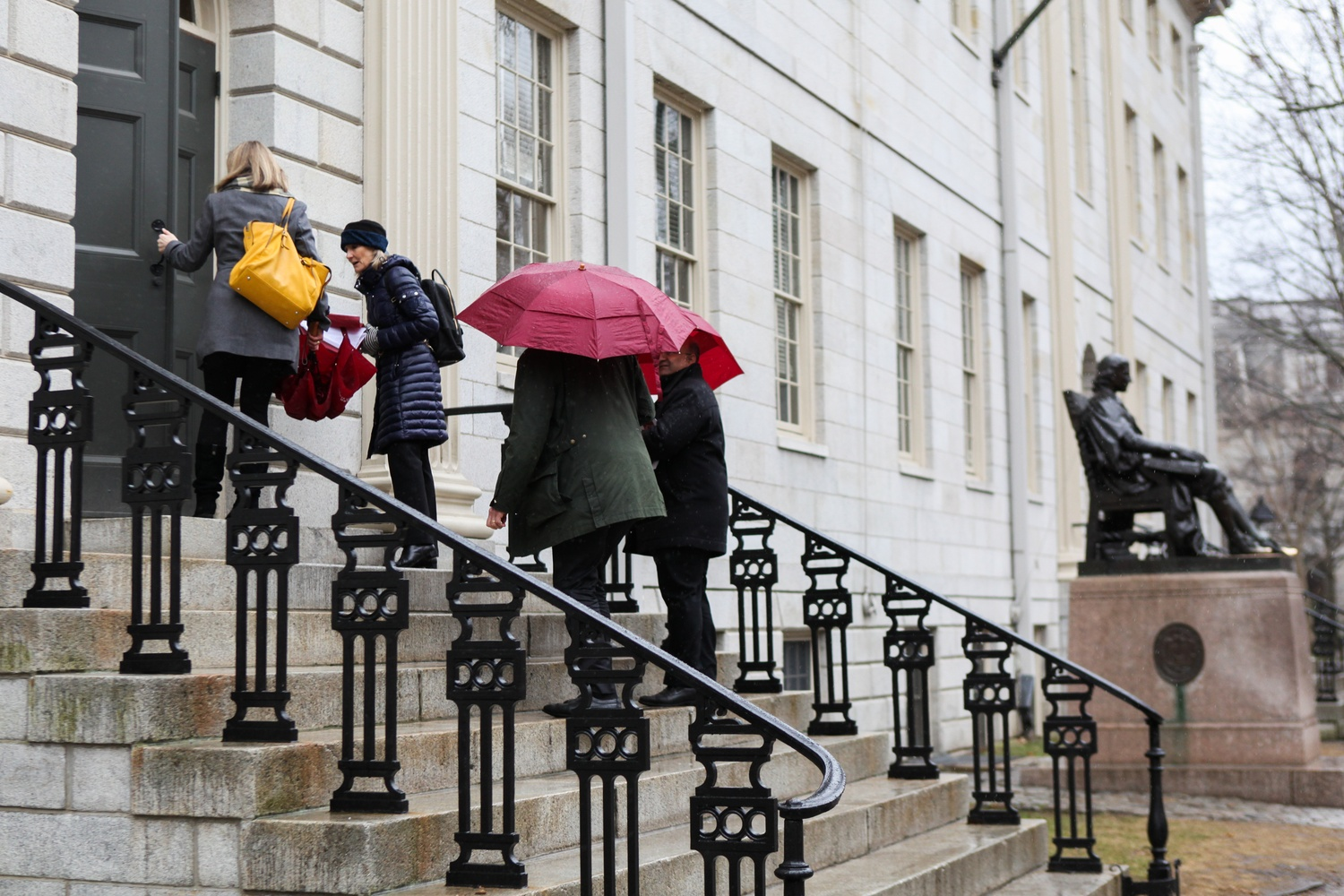 Faculty enter University Hall for their monthly faculty meeting on a rainy Tuesday afternoon in spring 2018.
