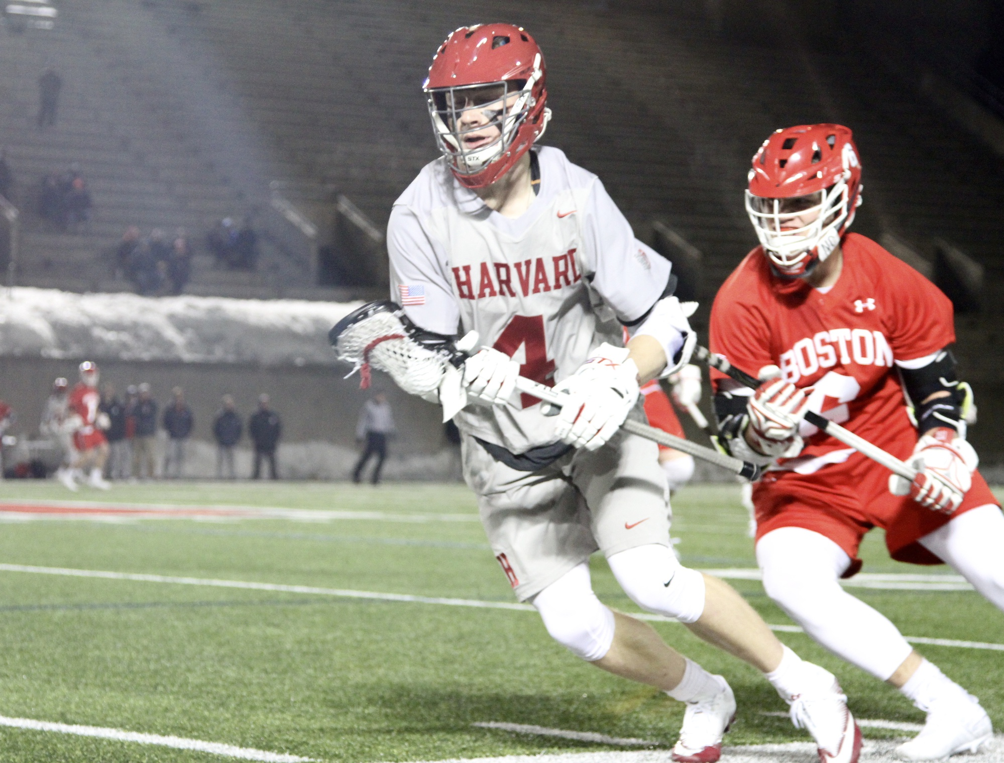 Freshman Charlie Olmert cradles the ball and turns upfield in a recent contest against Boston University.