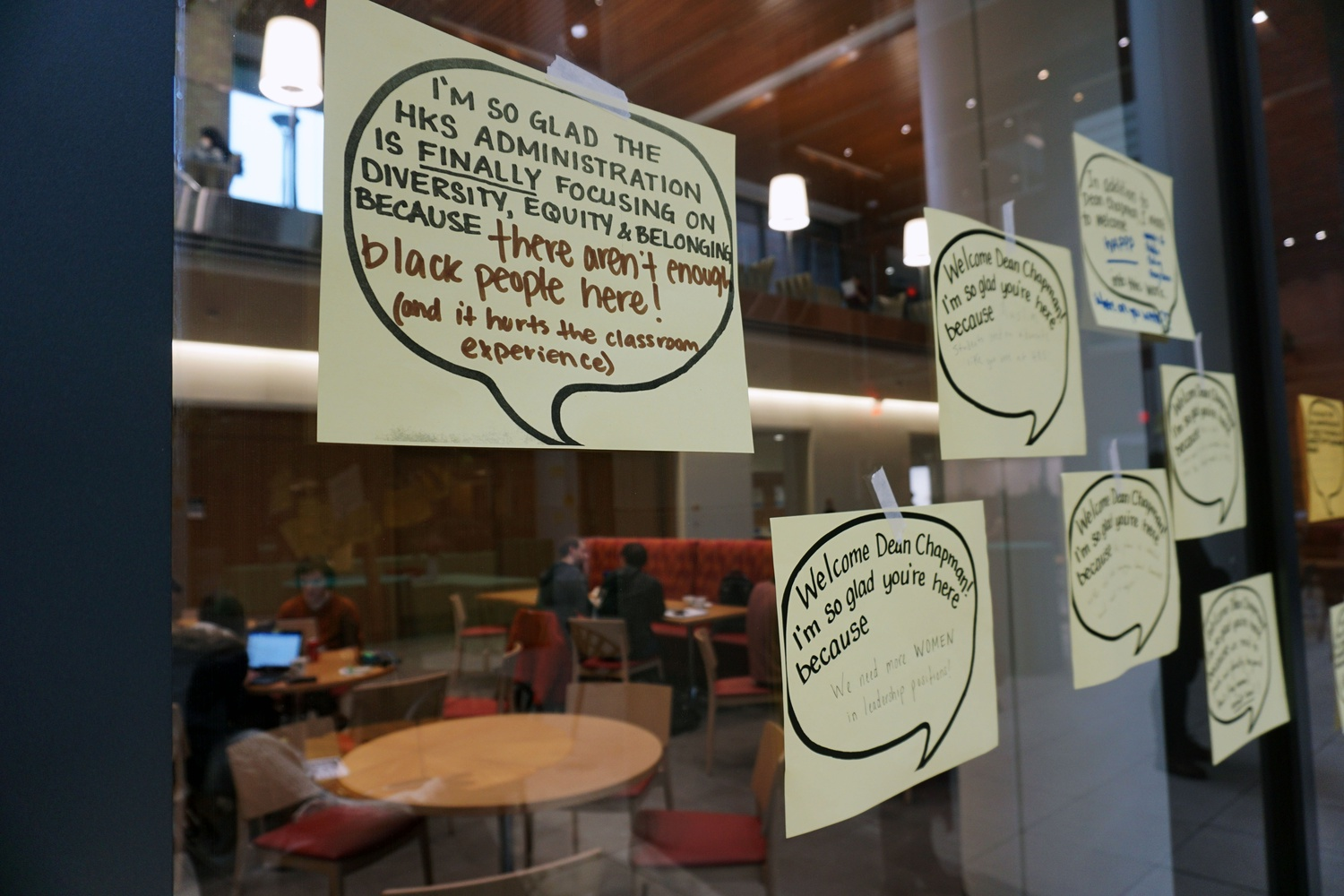 Signs posted on the walls of the Harvard Kennedy School welcoming the school's new diversity dean,  Robbin Chapman.