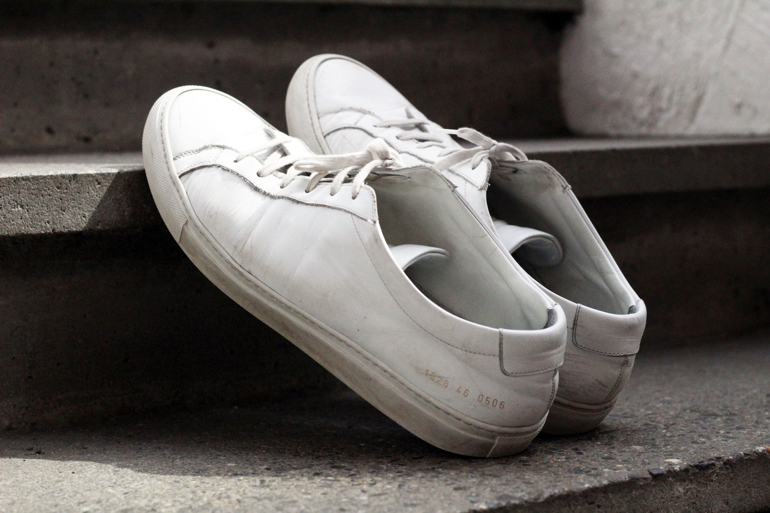 Alan R. Dai '21 has $350 Common Projects sneakers featuring gold numbers printed near the heel.