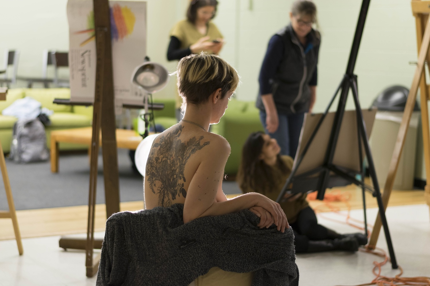 The model, Callista Womick, poses during the figure drawing class.