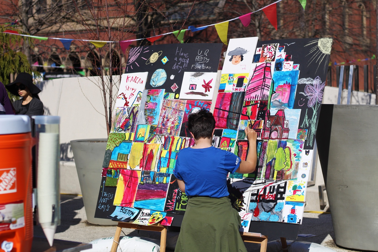 During Arts First in 2018, a student paints on a communal art display. Arts First — Harvard's annual art festival dedicated to promoting the arts — is being held virtually this year.