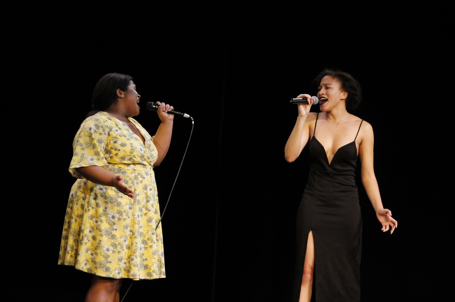 Samyra C. Miller '21 and Asia T. Stewart '18 sing during the No More Names concert Tuesday evening at The Agassiz Theater in Radcliffe Yard.