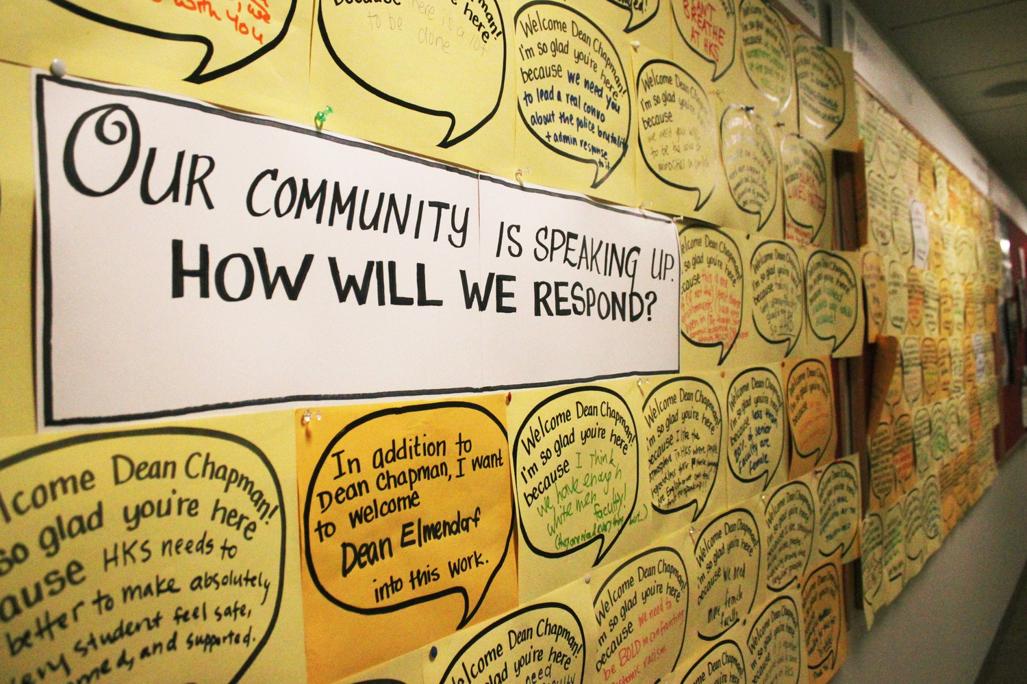A board of signatures to a pledge concerning diversity on campus is posted in the Harvard Kennedy School Littauer building.