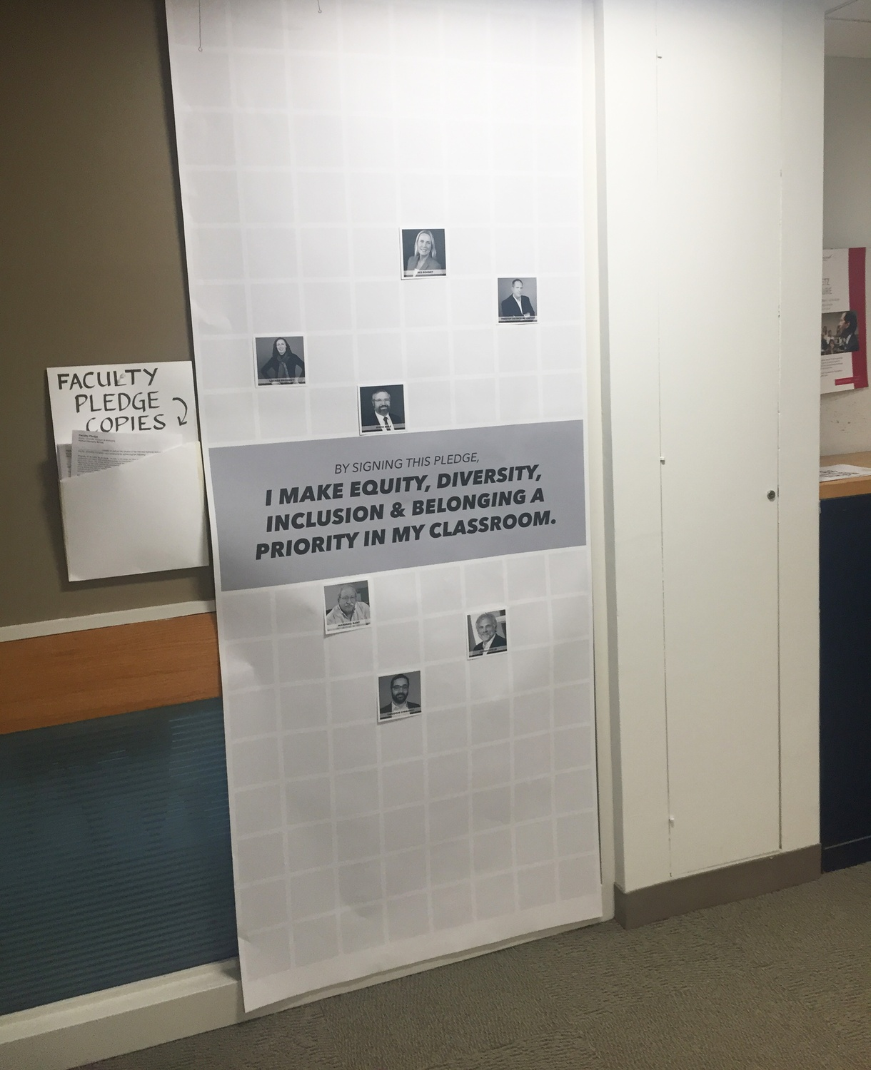 """A poster in a hallway at the Kennedy School displaying signatories of a faculty pledge to take part in efforts to increase diversity and inclusion at the school."""
