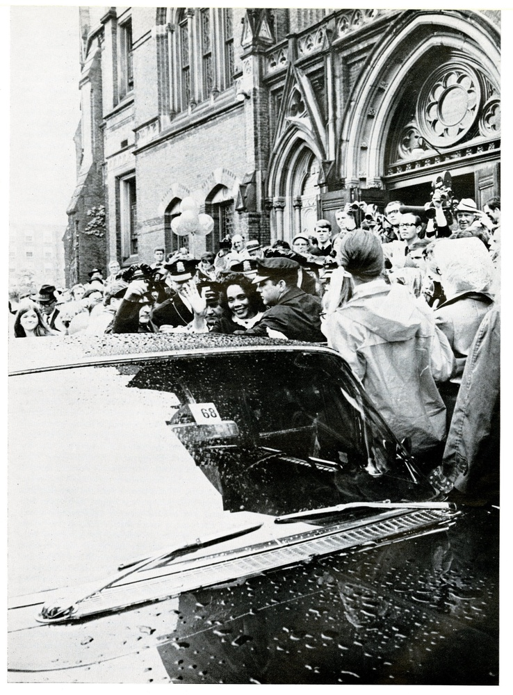 Coretta Scott King enters a car amidst throngs of press and students outside of Memorial Hall following her address to the Class of 1968.