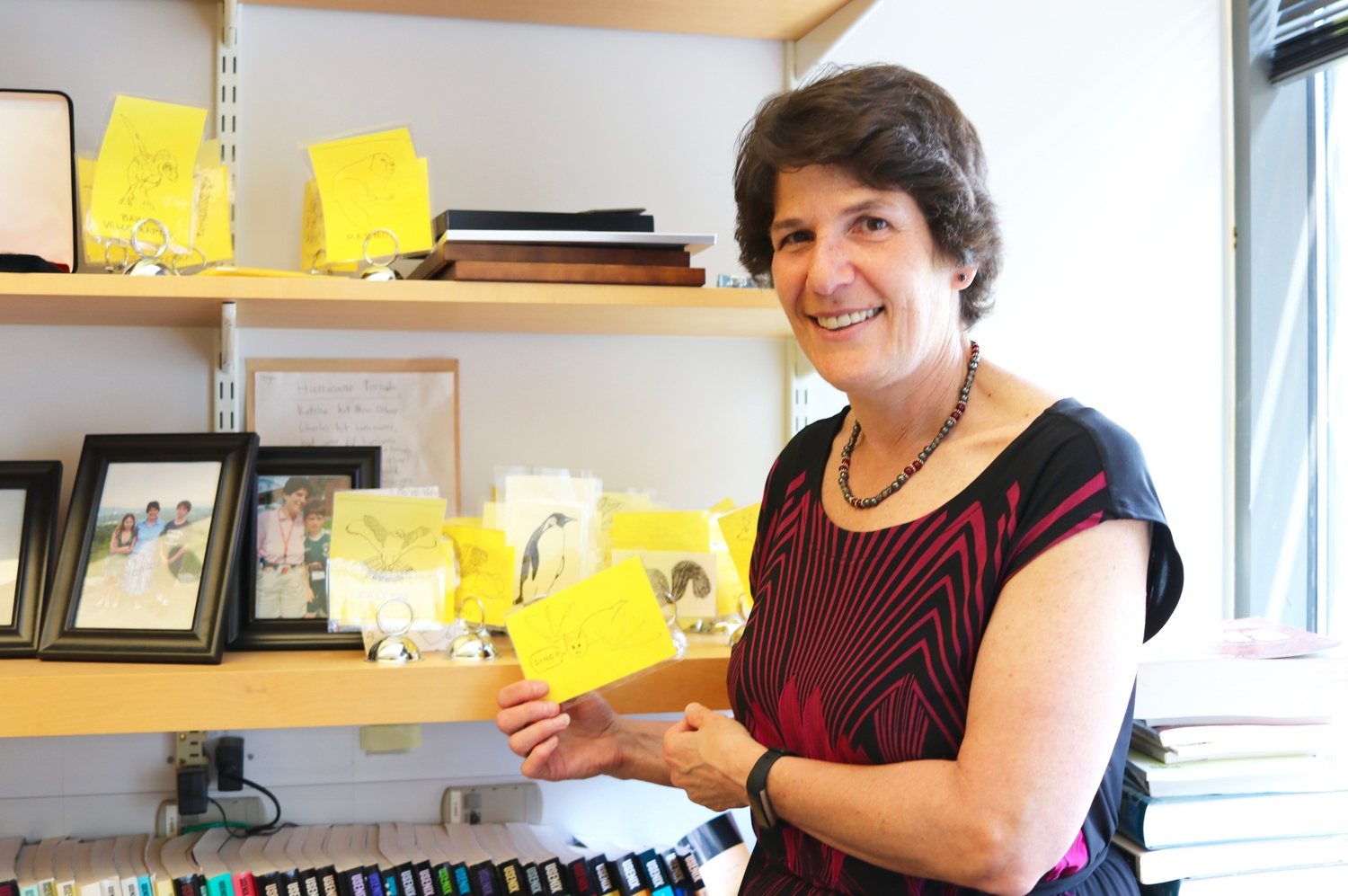 Margo I. Seltzer '83 poses with her computer science teaching tools in her office.