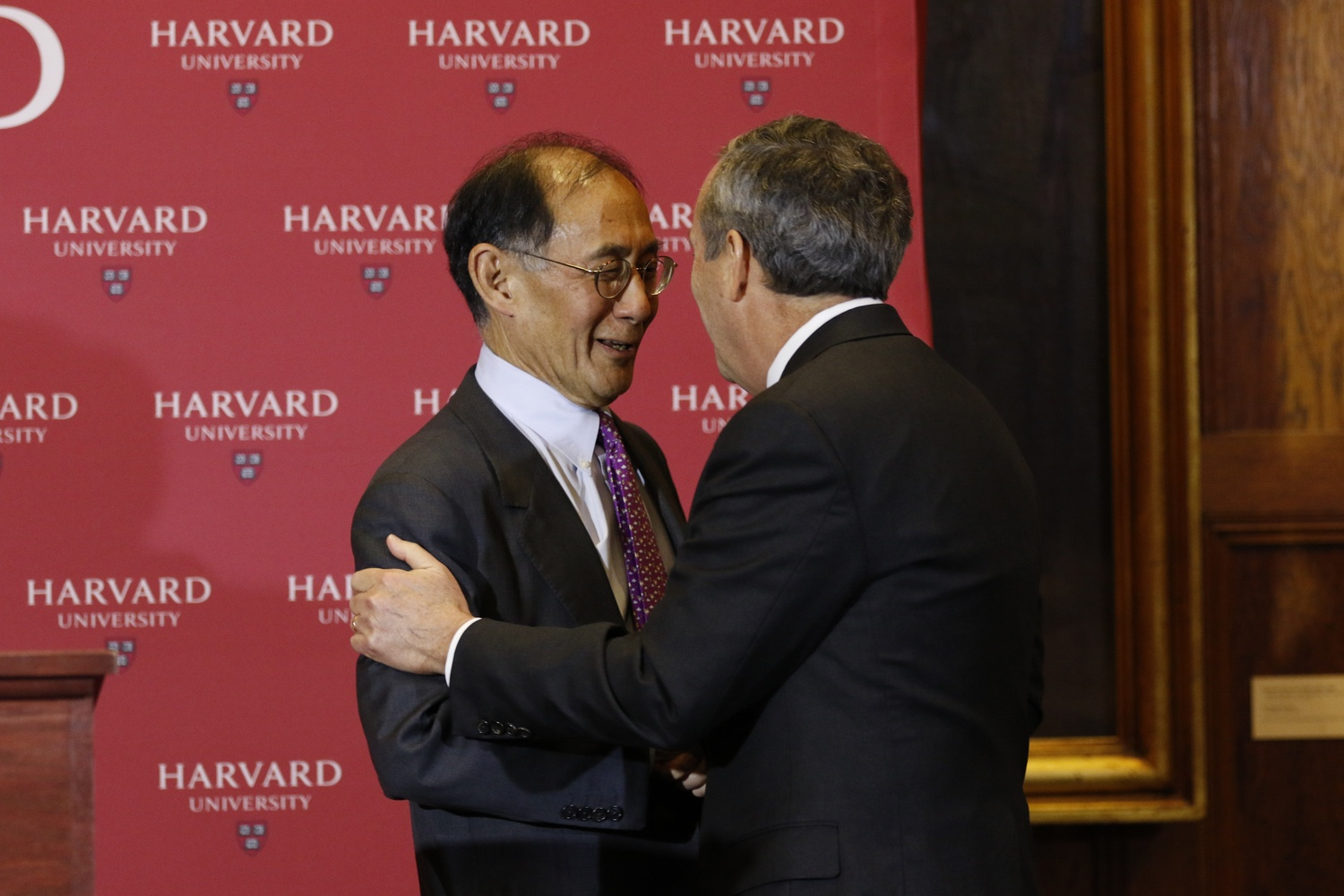 Harvard President-elect Lawrence S. Bacow and Senior Fellow of the Harvard Corporation William F. Lee '72 embrace at the press conference announcing Bacow's selection.