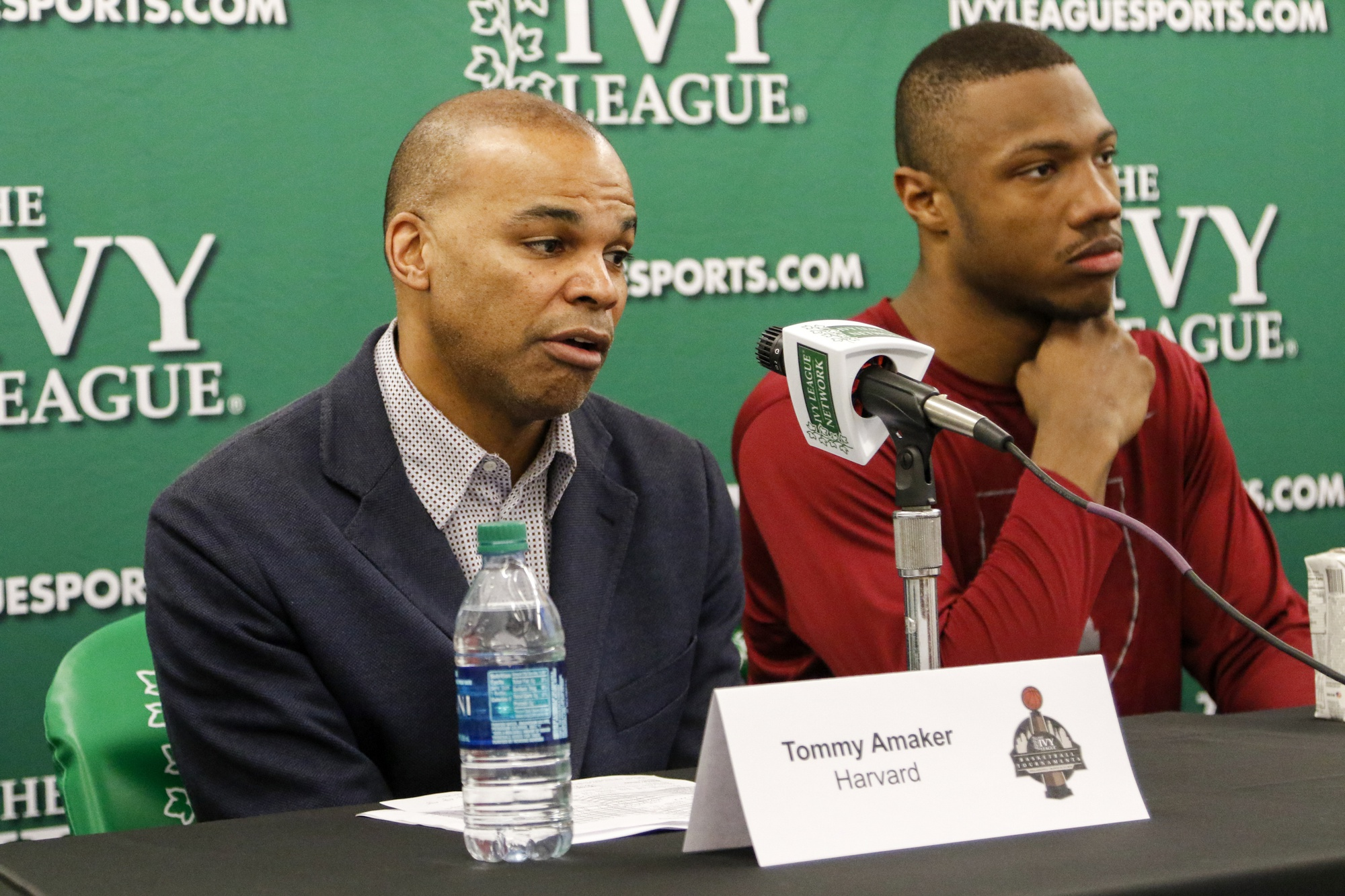 Coach Amaker and Chris Lewis address the media following the Crimson's win over Cornell in the Ivy League tournament. Amaker swayed Lewis—ranked the 68th best player in his class—to come to Cambridge despite having offers since 9th grade.