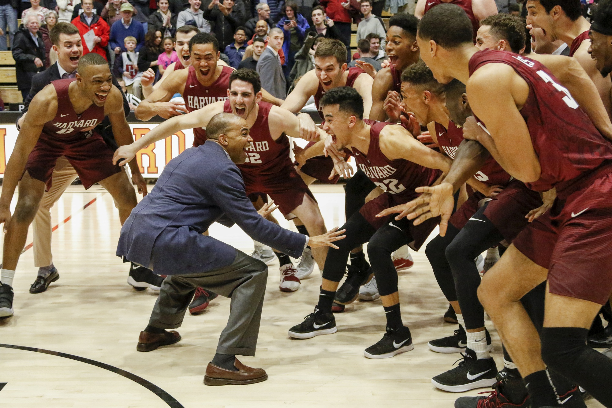 Head coach Tommy Amaker stands in front of his team following Harvard's 93-74 win against Columbia this season. The win gives the Crimson its sixth Ivy League title in eight years.