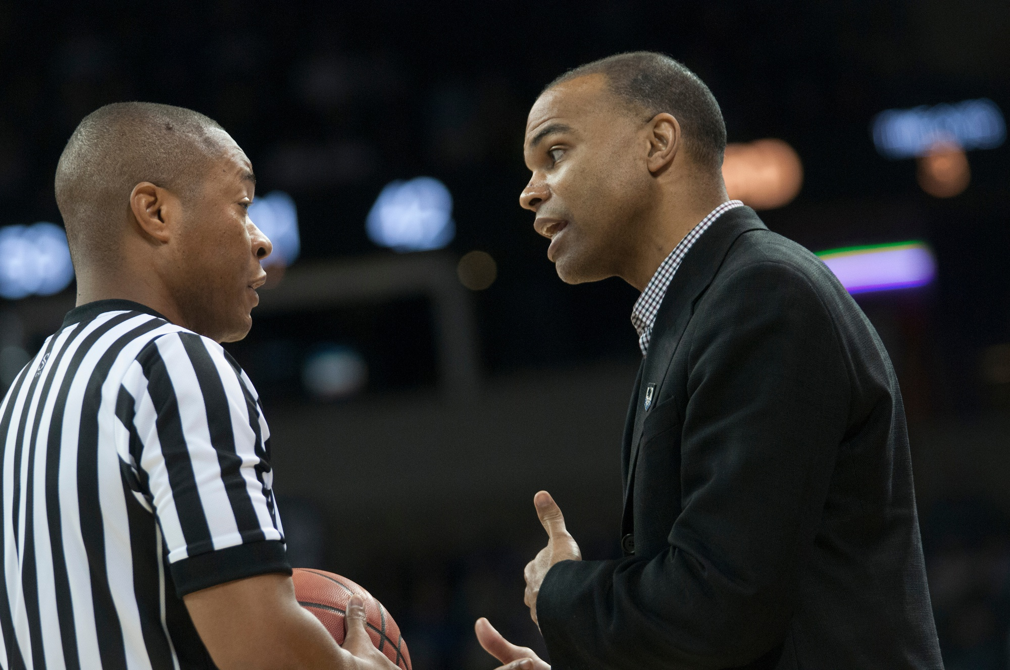 Coach Amaker talks with a ref during the Crimson's 2014 NCAA tournament game against Michigan State. The Crimson advanced to the third round that year after a win against Cincinnati. It marked Amaker's third tournament appearance in a row.