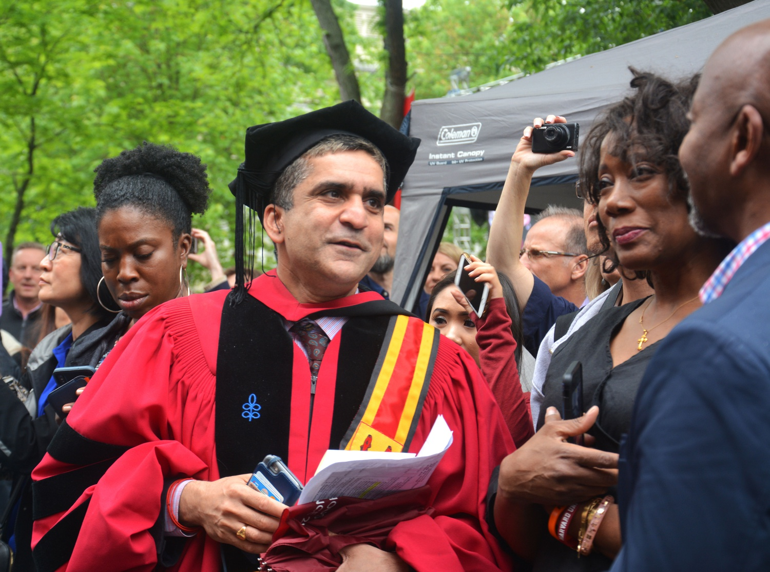 Dean Khurana greets parents and students in Tercentenary Theater before the class photo at Commencement in 2018.