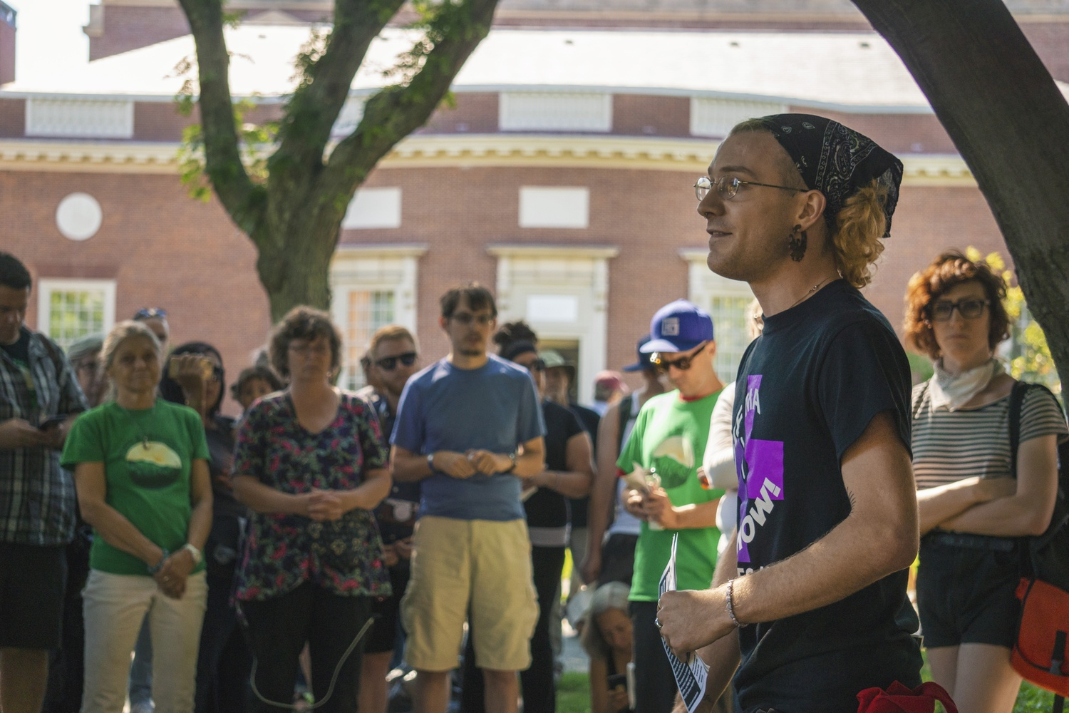 A crowd gathers in front of Lamont Library on Friday afternoon to protest the Arthur M. Sackler Museum.