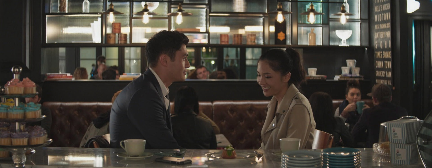"""Henry Golding as Nick and Constance Wu as Rachel in Warner Bros. Pictures' and SK Global Entertainment's and Starlight Culture's contemporary romantic comedy """"Crazy Rich Asians,"""" a Warner Bros. Pictures release."""