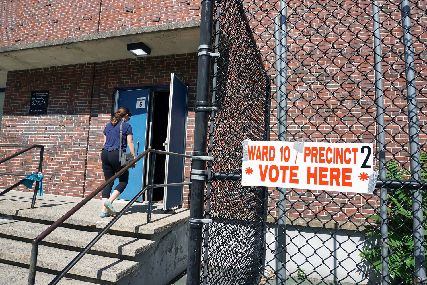 A voter enters Graham and Parks School to cast their ballot for the Massachusetts primary election.