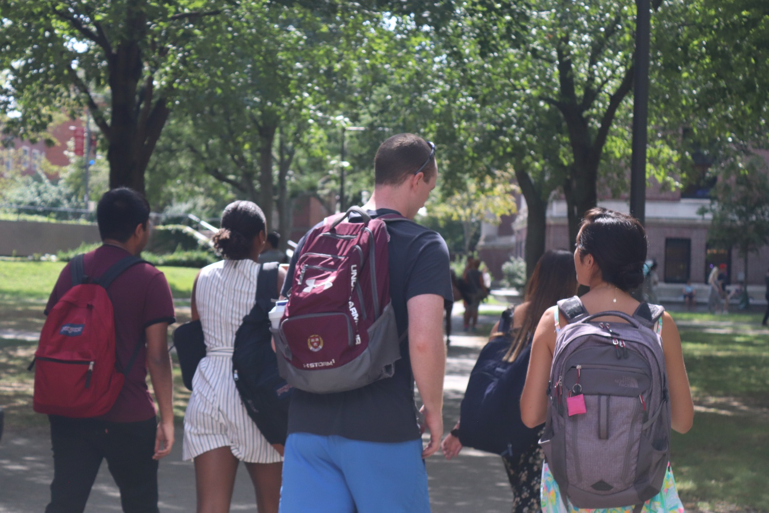 Students walk through sunny Tercentenary Theater on Tuesday, the first day of shopping week.