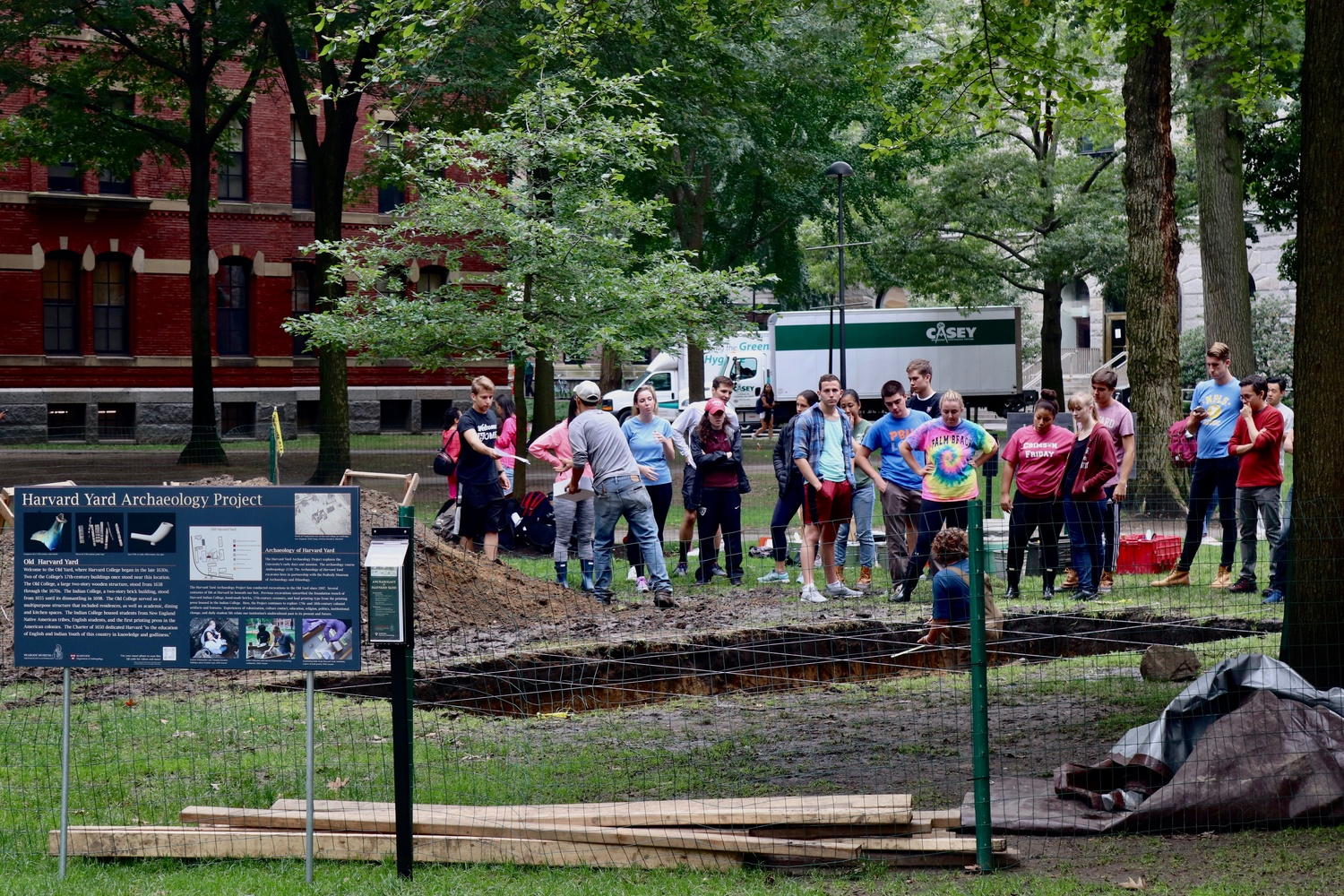 "1:08 p.m. Students taking ""The Archaeology of Harvard Yard"" spend class outside at a dig in the Old Yard, where they will be excavating the remains of some of Harvard's oldest buildings."