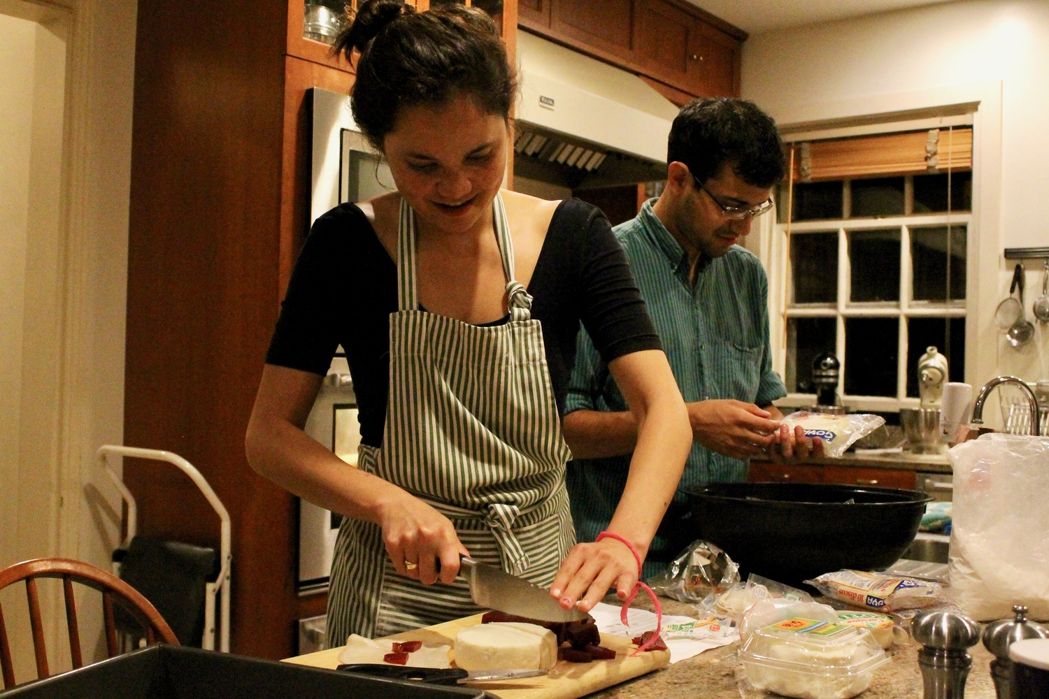 8:07 p.m. Andres Ballesteros '13 and Rebecca Cooper '11 bake in Apthorp House in preparation for Adams House Tea.
