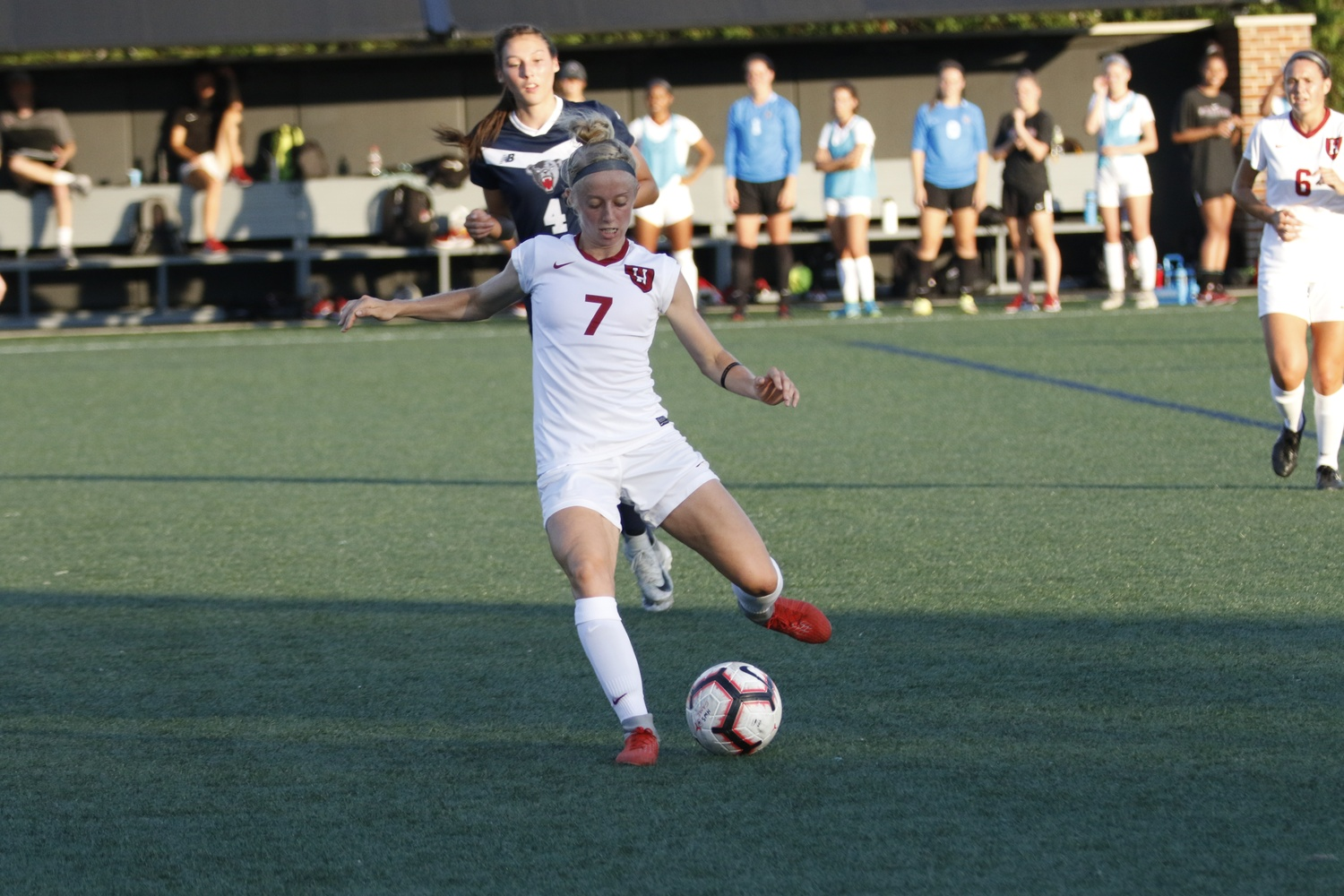 Junior Meg Tveit picks out a pass in action against Maine