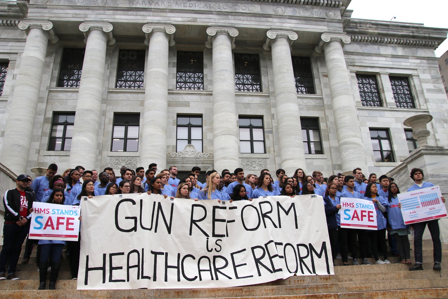 Harvard Medical School students rally against gun violence in front of Gordon Hall.