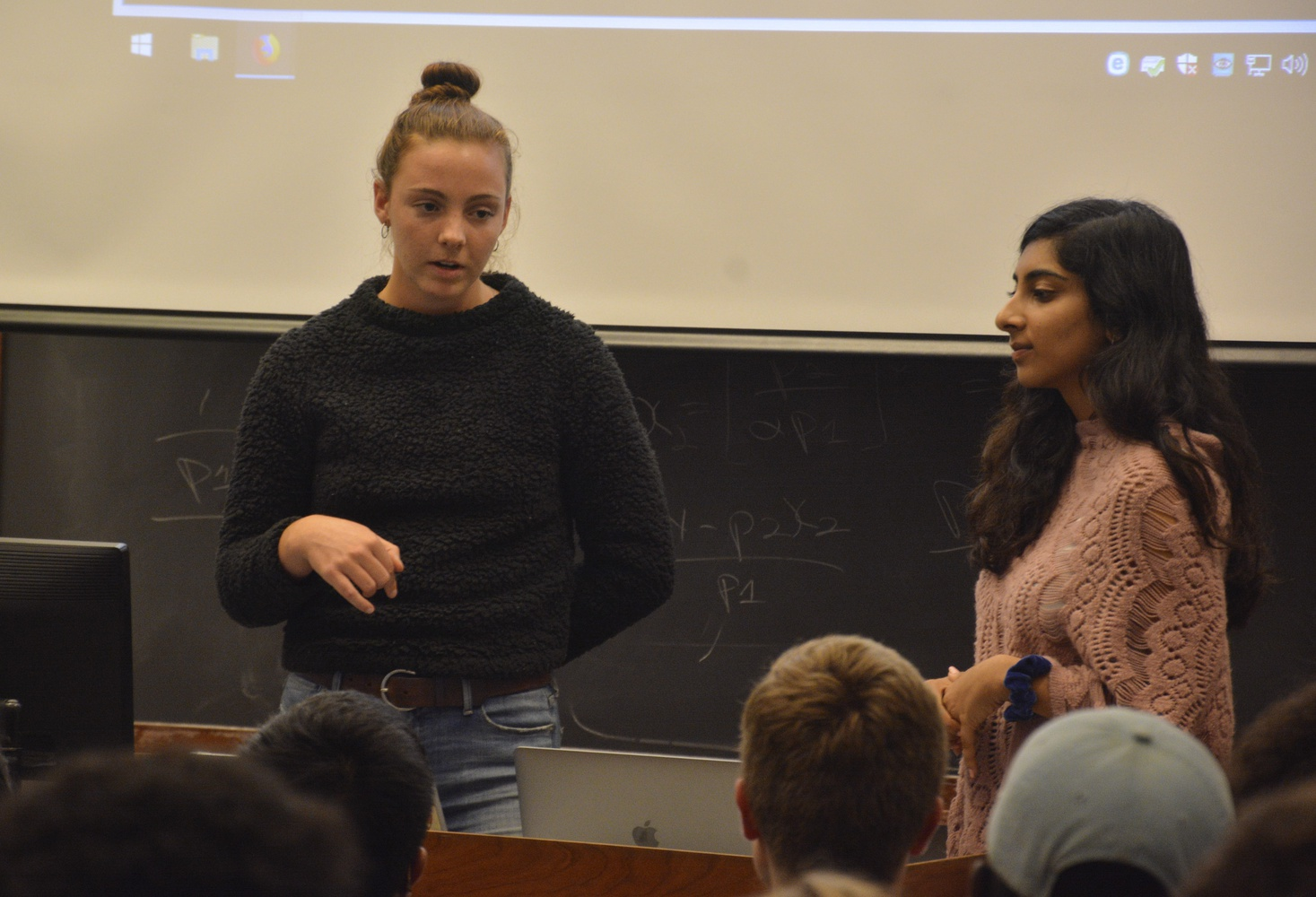 "Eleanor C. ""Nell"" Shea '20 and Priya P. Kukreja '21 from the Harvard College Reproductive Action and Dialogue speak about the implication of Judge Brett Kavanaugh's possible confirmation during a meeting with the Harvard College Democrats and Our Harvard Can Do Better Tuesday night."