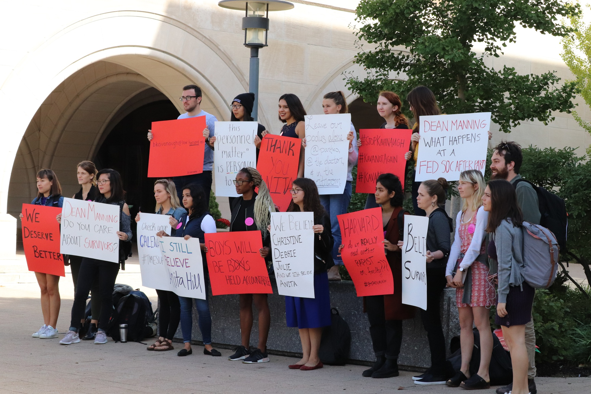 HLS students demonstrate against Kavanaugh's sexual assault case in front of the Law School.