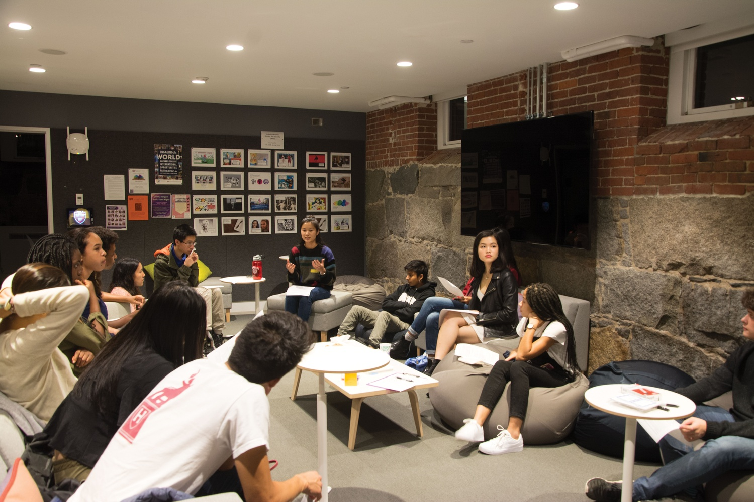 Students meet in Grays Hall Basement to discuss the ongoing affirmative action lawsuit against Harvard.
