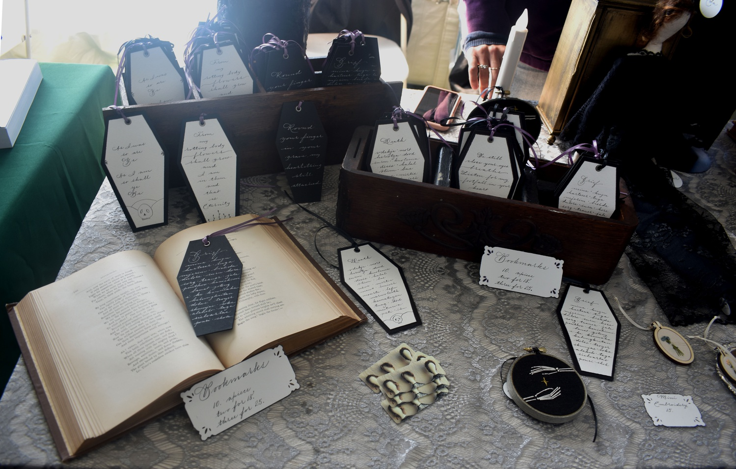 Bookmarks and other death-positive items are sold at the Death Salon.