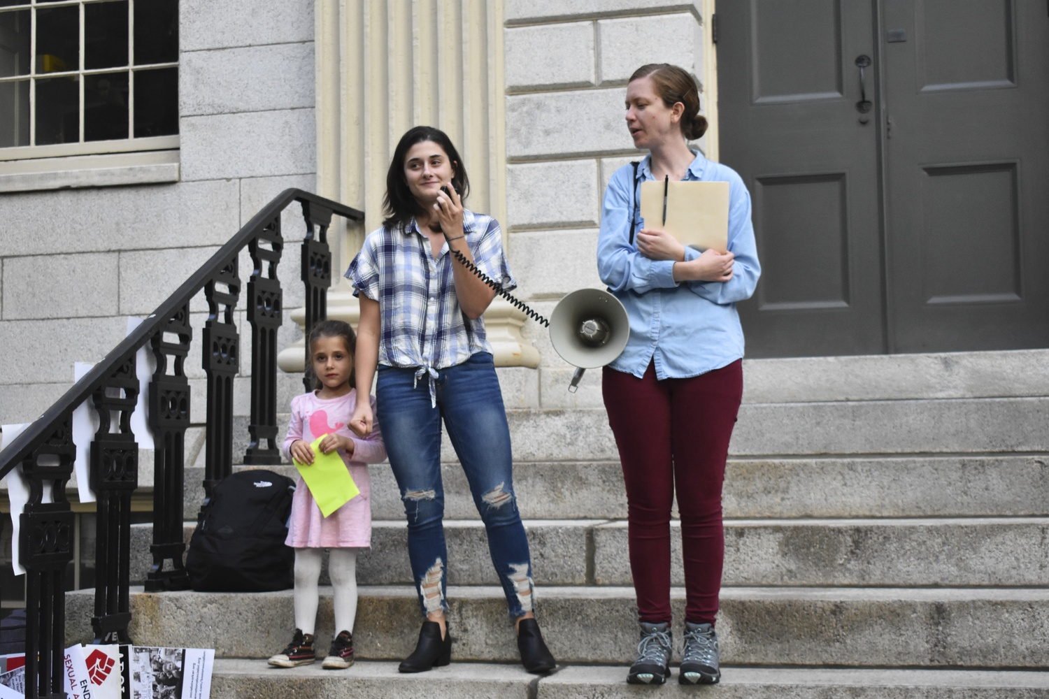 The Harvard International Socialists held a rally against the appointment of Brett M. Kavanaugh to the Supreme Court Thursday afternoon in front of the John Harvard Statue.