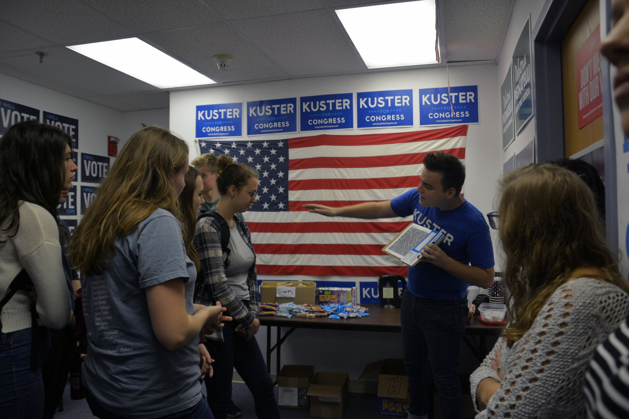Affiliates of the Harvard College Democrats learn their canvassing routes for a Sept. 22 trip to Nashua, NH.