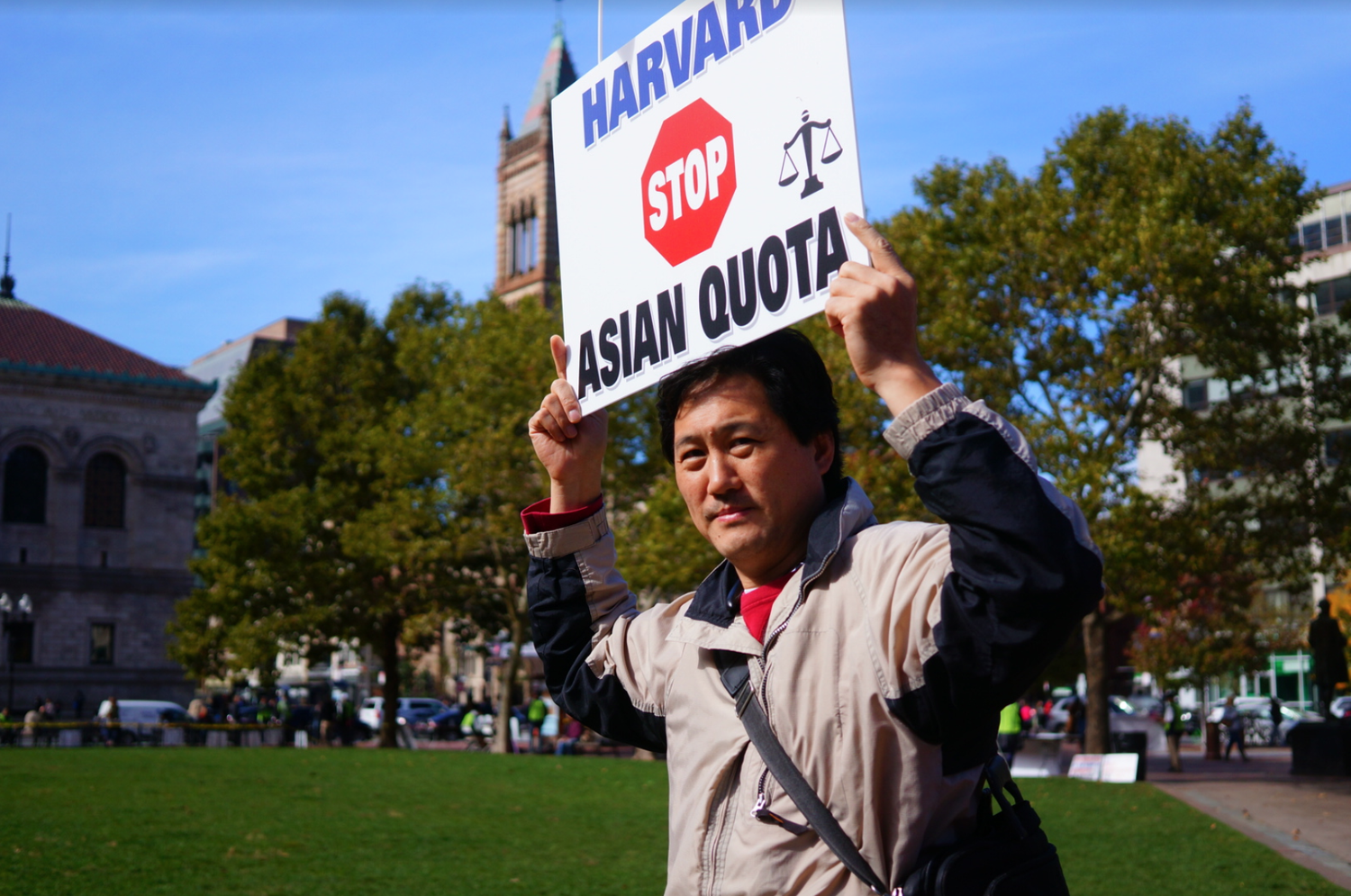 A protester at the pro-Students for Fair Admissions rally held in Copley Square Sunday. SFFA is suing Harvard over allegations it discriminates Asian-American applicants.