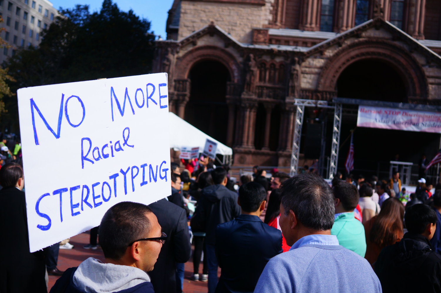 Demonstrators mill around during a pro-Students for Fair Admissions rally held in Copley Square Sunday.
