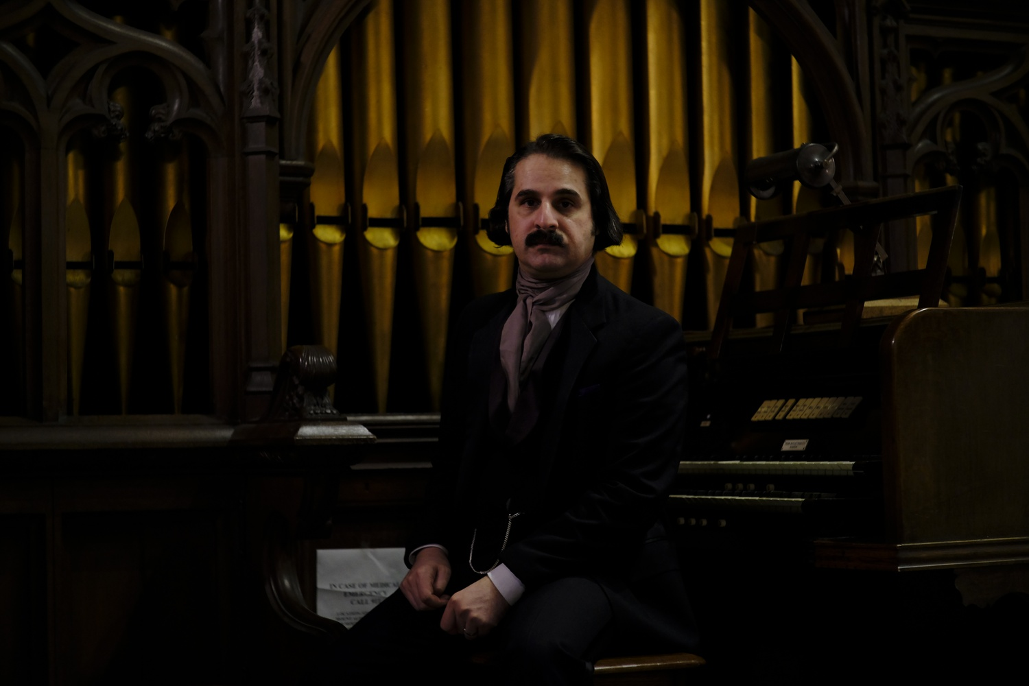 Edgar Allan Faux sits at a piano in Story Chapel.