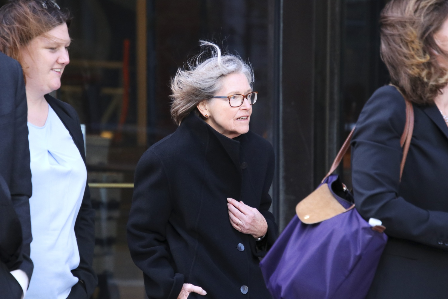 Director of Admissions Marlyn E. McGrath '70 exits the courthouse during the second week of the Harvard admissions trial.