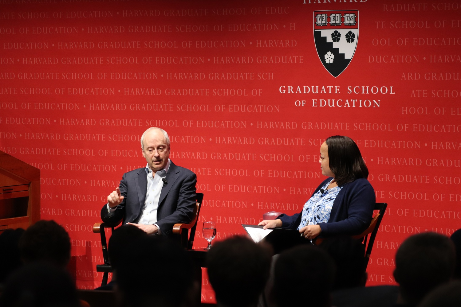Bridget Terry Long, a Professor of Education and Economics leads a discussion with Professor Michael  J. Sandel Thursday night in Longfellow Hall.