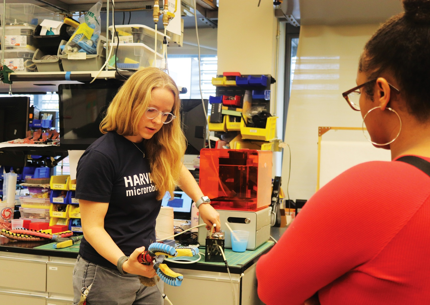 Kaitlyn P. Becker, a graduate engineering student who works on robotics, shows a group of visiting incarcerated youth how her gadgets work.