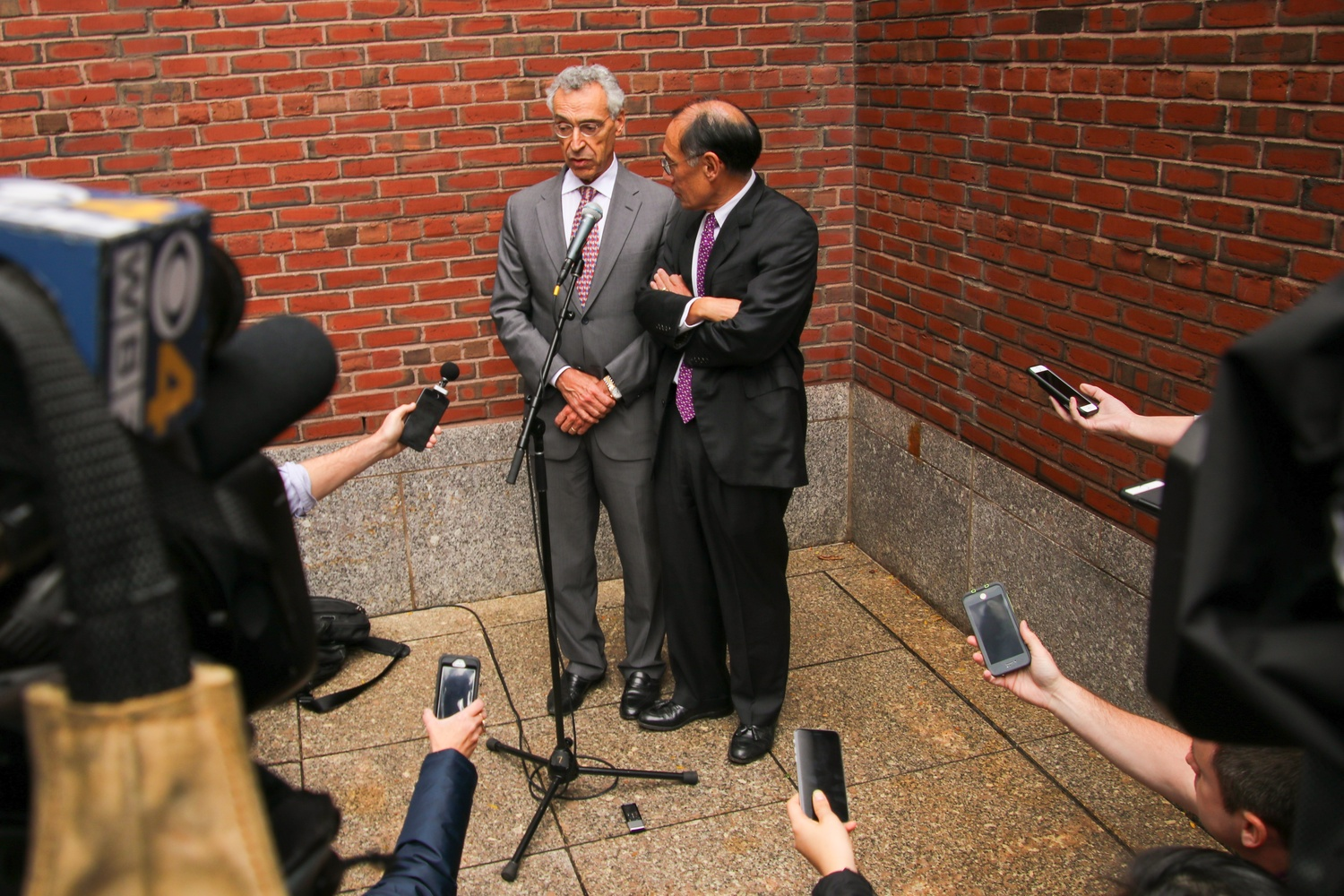 Seth P. Waxman '73 and William F. Lee '72 speak to members of the press outside John Joseph Moakley United States Courthouse immediately following the conclusion of the three-week-long Harvard admissions trial.