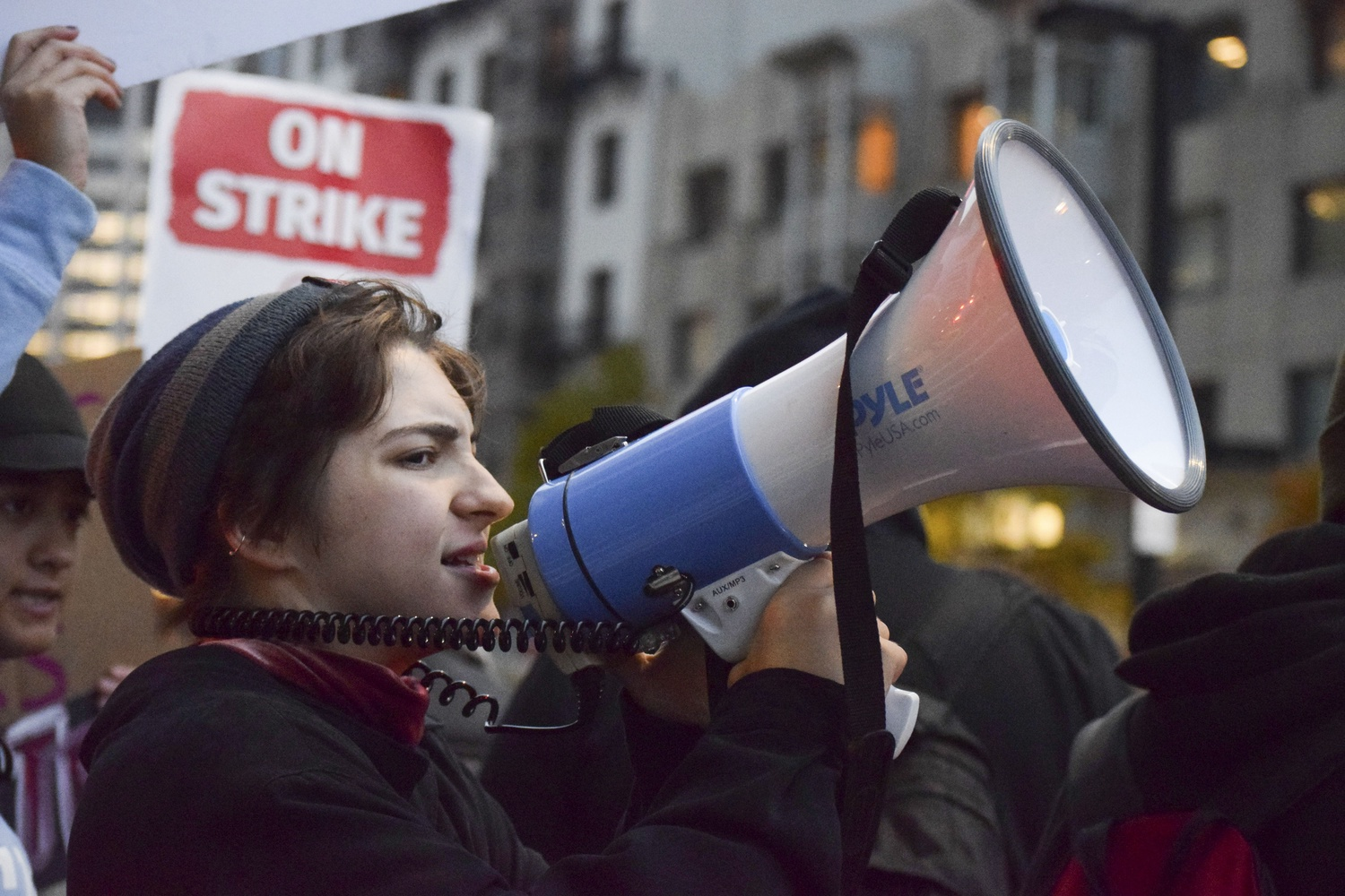 A protestor participates in a recent rally in downtown Boston that forms part of an ongoing strike by Marriott workers.