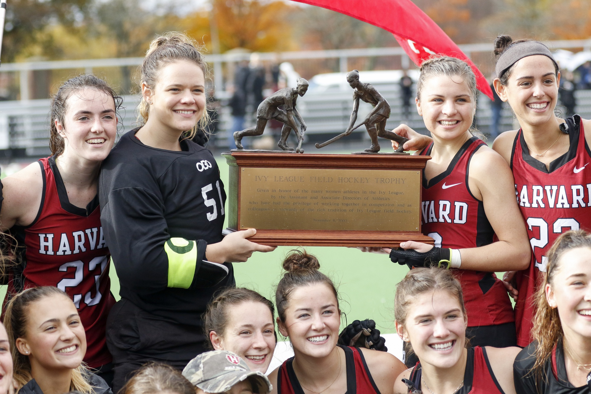 The field hockey team, ranked sixth in the nation, gathers around to pose with the Ivy League trophy.