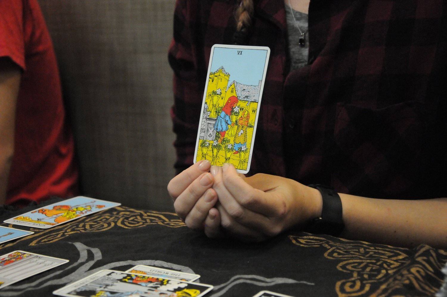 The tarot cards are intricately decorated.